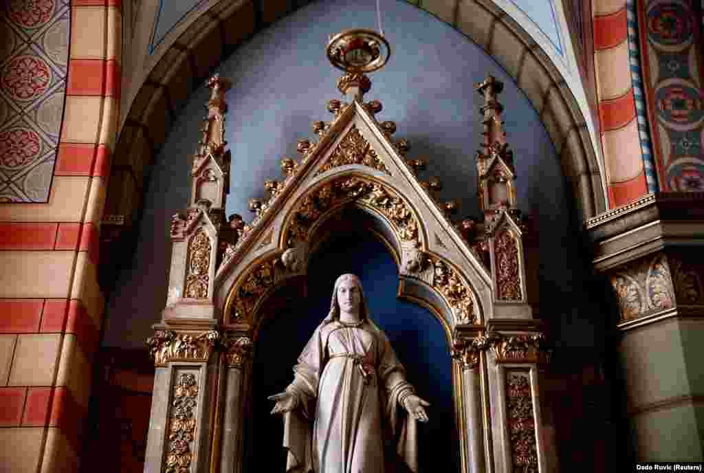 A statue stands inside the 19th century Sacred Heart Cathedral in Sarajevo.