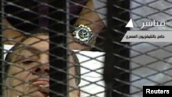 Egyptian TV shows former President Hosni Mubarak in the courtroom for his trial at the Police Academy in Cairo on August 3.
