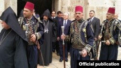 An Armenian delegation at the Church of the Holy Sepulchre in Jerusalem (file photo)