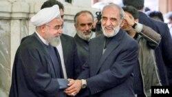 حسن روحانی رئیس جمهور و حسین شریعتمداری مدیر مسئول کیهان