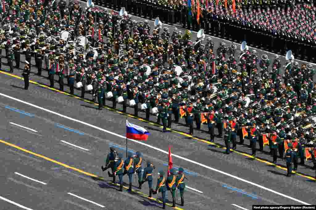 Russian servicemen attend the Victory Day parade.  Russia has reported 600,000 coronavirus infections, giving it the third-highest number in the world. The official death toll stands at more than 8,000, but the real number is believed to be much higher.
