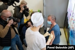 A medical worker administers a dose of Sputnik V in Moscow on April 7. The vaccine was heralded as a success, even though it hadn't undergone the typical three-phrase process of clinical tests.