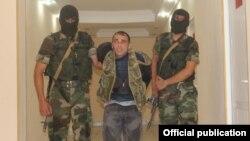 Azerbaijan - Azerbaijan soldiers escort Karen Petrosian, an Armenian man arrested after crossing into Azerbaijan, 7Aug2014