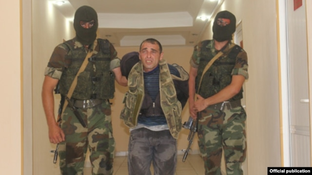 Azerbaijan - Azerbaijan soldiers escort Karen Petrosian, an Armenian man arrested after crossing into Azerbaijan, 7Aug2014