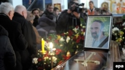 Mourners pass the coffin and photo of Yuriy Verbytskyy, a 51-year-old activist and antigovernment protester on Kyiv's Independence Square, during his funeral in Lviv on January 24.