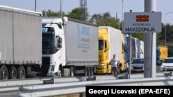 """Trucks wait on the border between Serbia and North Macedonia. """"I remember in 2007, when there were three or four vehicles at the border...And now, I think it's never under 50 vehicles,"""" says Serbian businessman Dragan Stojsin. (file photo)"""