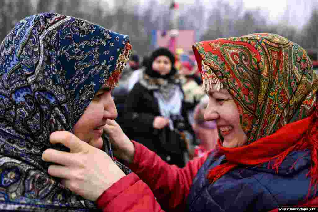 Traditionaly dressed Russian women celebrate Maslenitsa in the village of Gzhel.