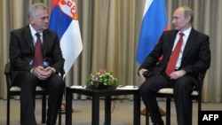 Russia's President Vladimir Putin (right) and Serbia's President-elect Tomislav Nikolic in Moscow on May 26.