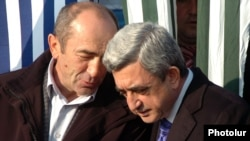 Armenia - President Serzh Sarkisian (R) and his predecessor Robert Kocharian at an official ceremony outside Yerevan, 01Dec2008.