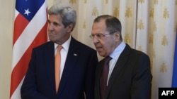 Russia -- Russian Foreign Minister Sergei Lavrov (R) greets US Secretary of State John Kerry during a meeting in Moscow, March 24, 2016