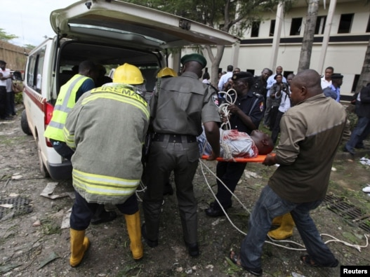A victim of the blast at the UN offices is loaded into an ambulance in Abuja.