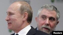 «Ռուսական ֆորում» միջազգային համաժողովի մասնակիցներ Ռուսաստանի վարչապետ Վլադիմիր Պուտինը և Պրինստոնի համալսարանի պրոֆեսոր, տնտեսագետ Փոլ Կրուգմանը, Մոսկվա, 2-ը փետրվարի, 2012թ.