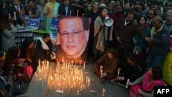 Pakistani activists light candles on the anniversary of the death of the governor of Punjab Province, Salmaan Taseer, in Lahore on January 4, 2016.