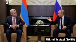 RUSSIA -- President Vladimir Putin (R) meets with his Armenian counterpart Serzh Sarkisian in Sochi, August 23, 2017