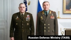 U.S. Chairman of the Joint Chiefs of Staff General Mark Milley (left) poses with his Russian counterpart, Valery Gerasimov, during their meeting in Helsinki on September 22.