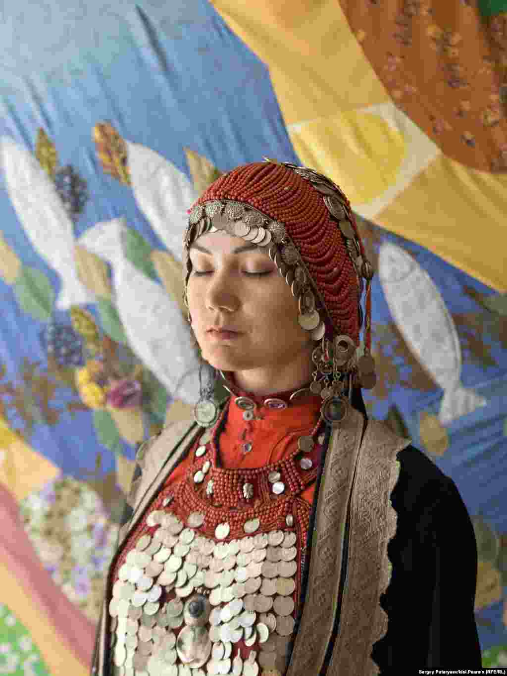 "Regina 29 years old, art historian ""I think that the goal for a Bashkir girl is to be worthy of her nation and its history. It's important, while possessing gadgets, to build traditions into modern realities. I have made the breastplate necklace myself and I plan to use ethnic patterns in my wardrobe further on."""