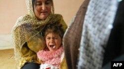 Arxiv foto: 4 yaşlı Shwen sünnət olunduğu üçün ağlayır