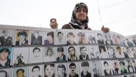 "A member of the ""Mothers of Srebrenica"" demonstrates in front of the European Court of Human Rights (CEDH) in Strasbourg on October 11."