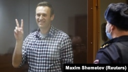 Russian opposition politician Aleksei Navalny at a hearing in Moscow to consider an appeal against an earlier court decision to change his suspended sentence to a real prison term on February 20