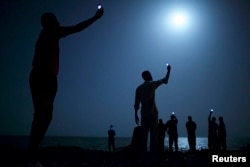 John Stanmeyer, a U.S. photographer working for VII agency on assignment for National Geographic, won the World Press Photo of the Year 2013 contest with this picture of African migrants on the shore of Djibouti city at night, taken on February 26, 2013.