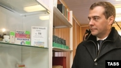 A stiff-looking Medvedev visits a maternity hospital in Volkhovets in 2007.