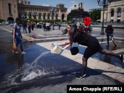 "Sona Ghazarian, 20, cleans Republic Square along with her university classmates. The linguistics student says her group headed to the square, which was the scene of a huge protest rally on May 2, and will spend three hours scrubbing it clean. ""We have come here because we love our country, and we want to show our support for what is happening on the streets. I want everything in my country to be fair. We all love Armenia and we want the best for her."""