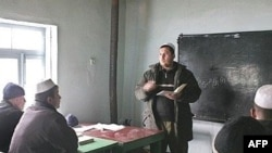 Tajiks study at a local religious school in Gisar in February 2007.