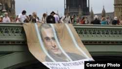 Activists in London unfurl banner wishing Mikhail Khodorkovsky a happy birthday, 26Jun2012