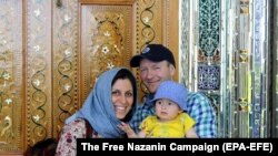 IRAN -- British-Iranian woman Nazanin Zaghari-Ratcliffe (L) with her husband Richard Ratcliffe and daughter Gabriella, undated