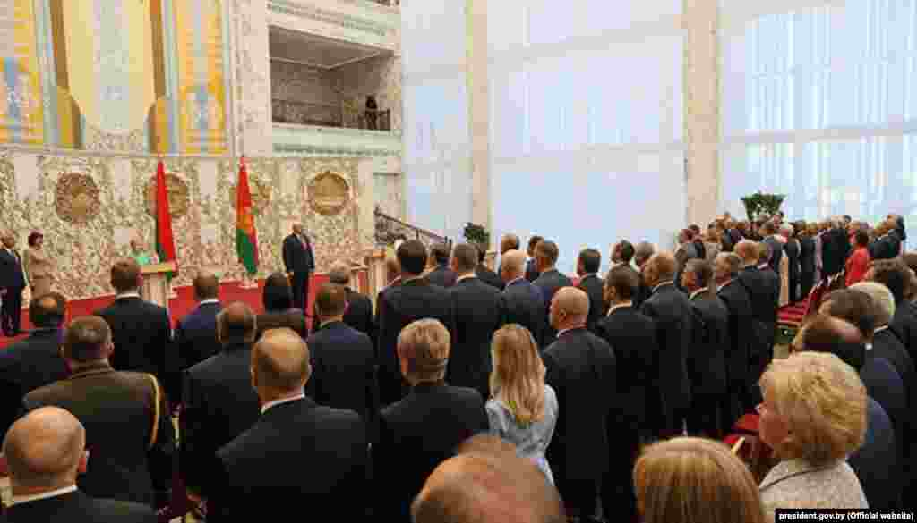 Lukashenka was sworn in for a sixth term in front of several senior officials. He put his right hand on the constitution and took the oath of office, before signing it.