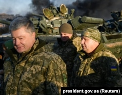 Ukrainian President Petro Poroshenko (left) and Defense Minister Stepan Poltorak (right) visit a training center of the Ukrainian Army's ground forces in the Chernihiv region, which is under martial law, on November 28.