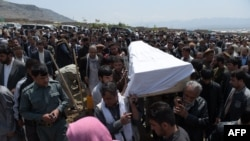 Afghanistan -- Relatives and loved ones carry the coffin of a victim killed in the April 19 Taliban truck bomb attack, at a funeral in Kabul, April 20, 2016