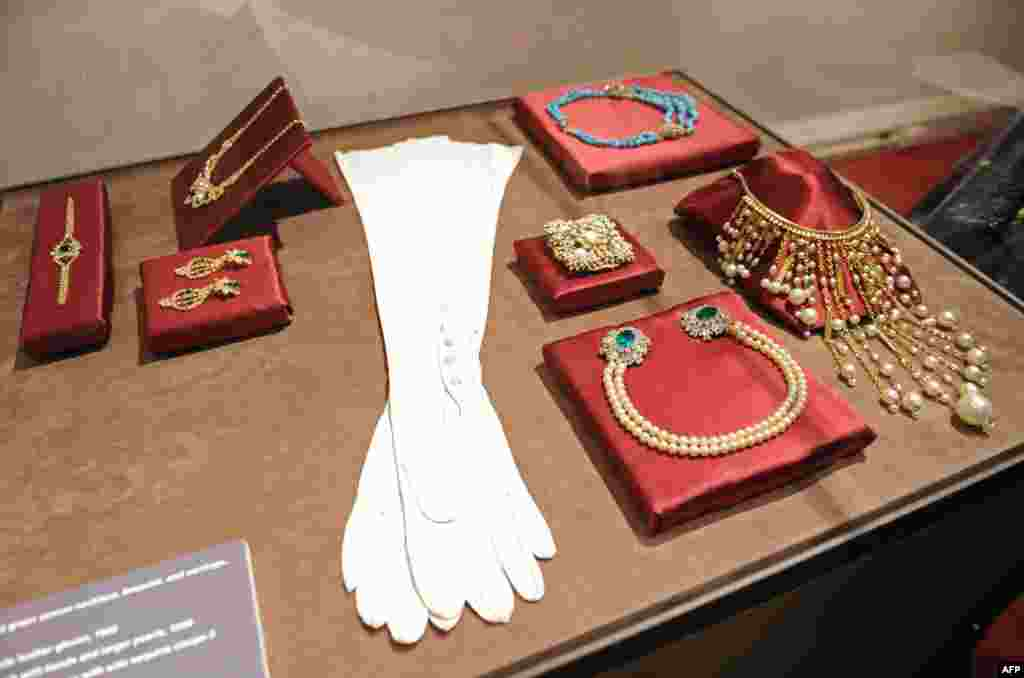 "White leather gloves worn by the opera singer Maria Callas in ""La Traviata"" along with pieces of jewelry she wore, displayed in the exhibition, ""Maria Callas: A Woman, a Voice, a Myth"" at the Italian Cultural Institute in New York in 2011"
