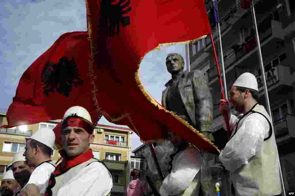 Kosovars wave Albanian flags as they take part in celebrations marking the sixth anniversary of Kosovo's declaration of independence from Serbia in Pristina on February 17. (AFP/Armend Nimani)