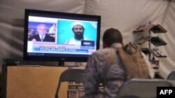 U.S. Marines watch TV announcing the death of Osama Bin Laden in May 2011