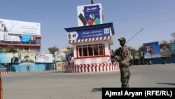 Afghan security forces stand guard in Kunduz city on August 31.