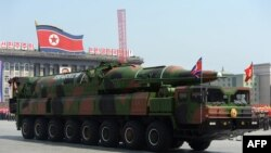 North Korea -- A military vehicle carries what is believed to be a Taepodong-class missile Intermediary Range Ballistic Missile, about 20 meters long, during a military parade to mark the 100 birth of Kim Il-Sung in Pyongyang, 15Apr2012