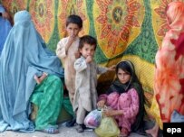 A woman and her family arrive in Peshawar after fleeing the restive Bajaur tribal area.