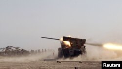 Iraqi soldiers fire a Grad missile during training at the Basmaya military base in Baghdad in November.