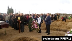 A funeral for one of the victims of the factory explosion in Pinsk on October 27
