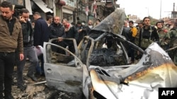 Syrians gather at the site of a car-bomb explosion in Syria's coastal city of Jableh on January 5.
