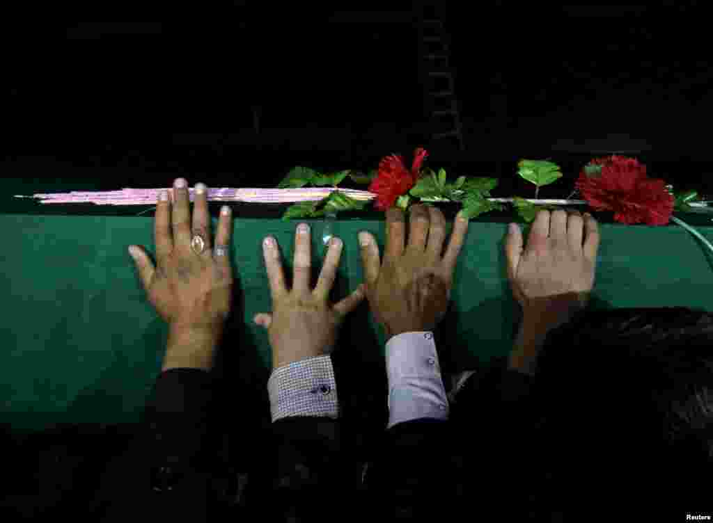 Protesters carry the coffin of one of the seven minority ethnic Hazaras who were killed by militants in Kabul. The protesters called for a new government that can ensure security in the country. The four men, two women, and a child were found partially beheaded on November 7 in the southeastern province of Zabul.  (Reuters/Mohammad Ismail)