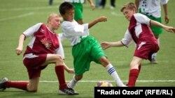 Иллюстративное фото - игра детских футбольных команд России и Таджикистана, 6 августа 2012 года.