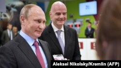 Russian President Vladimir Putin (left) poses with his FAN ID for the 2018 FIFA World Cup Russia as FIFA President Gianni Infantino stands nearby in Sochi last month.