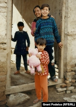 Anwari's daughters play outside their home in Kabul in November 2002.