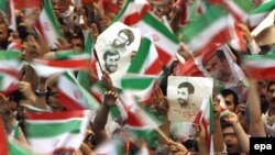 Supporters of President Mahmud Ahmadinejad rally in Tehran on June 8.