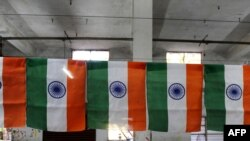 India -- A worker folds an Indian National Flag at Roopalee Textiles in Ahmedabad, 19Jan2010
