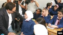 UNHCR Goodwill ambassador Egyptian Adel Imam (left) in a 2007 photo while touring Syrian schools to check the conditions of Iraqi students in Damascus.