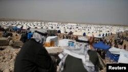 У лагеря для беженцев под иракским городом Мосул.
