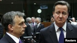 Hungary's prime minister, Viktor Orban (left), talks with British Prime Minister David Cameron at a European Union summit in Brussels on January 30.
